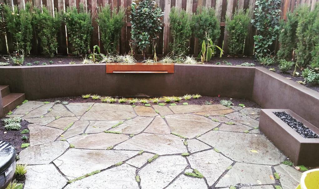 Backyard built in concrete seat wall firepit