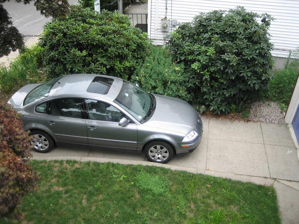 Car on concrete driveway