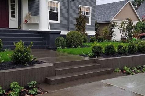 Sand finish concrete steps retaining wall