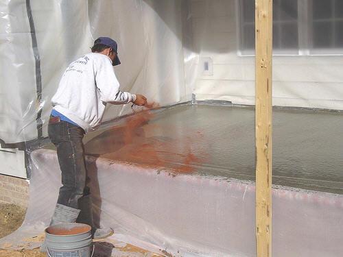 Applying color hardener to concrete